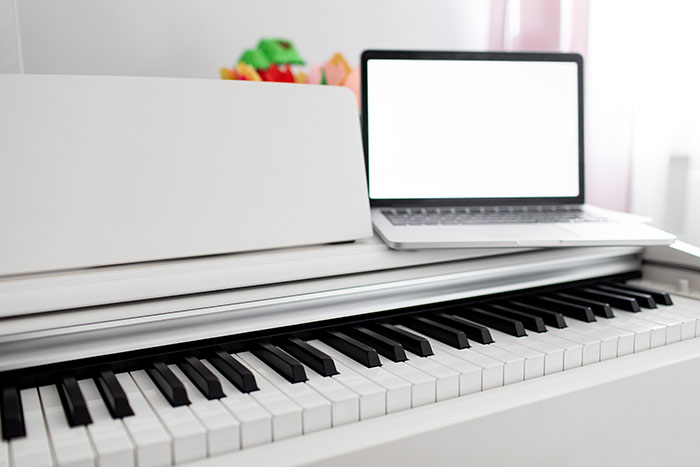 laptop on top of the piano feat