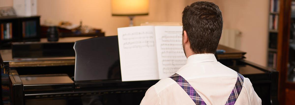 man practising the piano