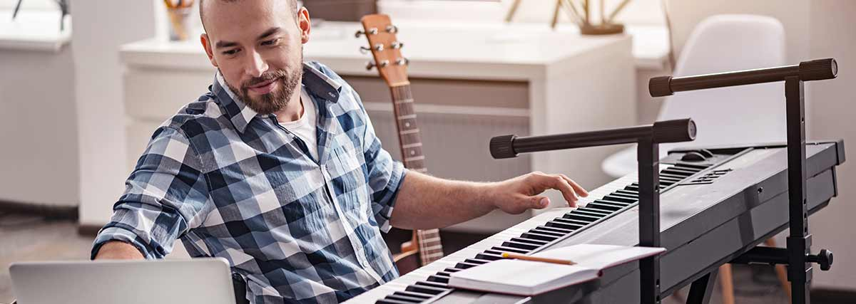 man teaching piano online