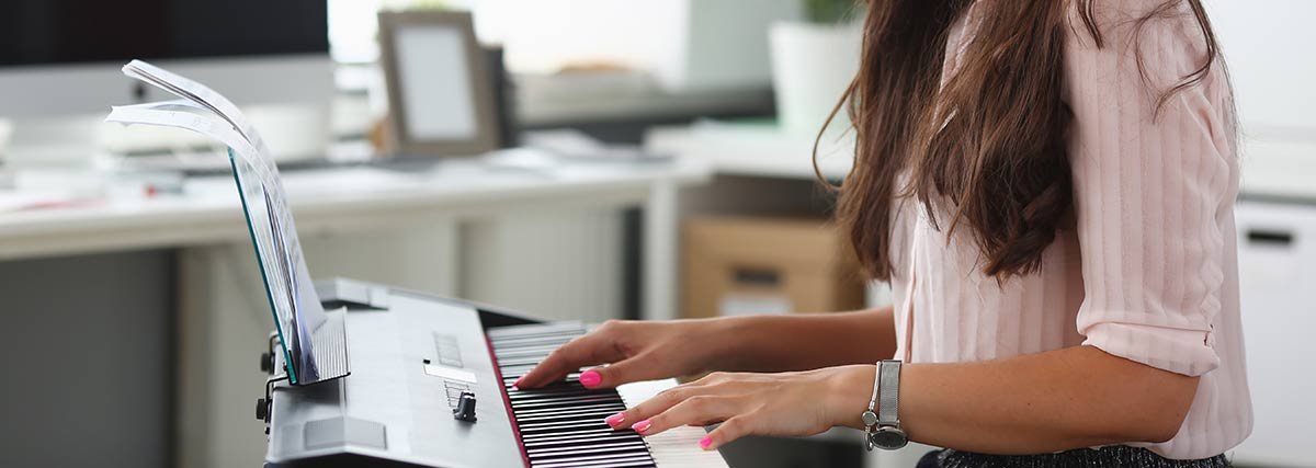 woman practising the piano at home
